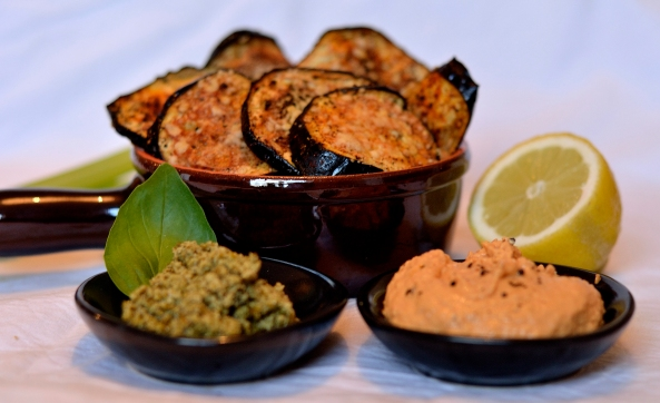 Aubergine crisps with homemade red pepper hummus and green pesto