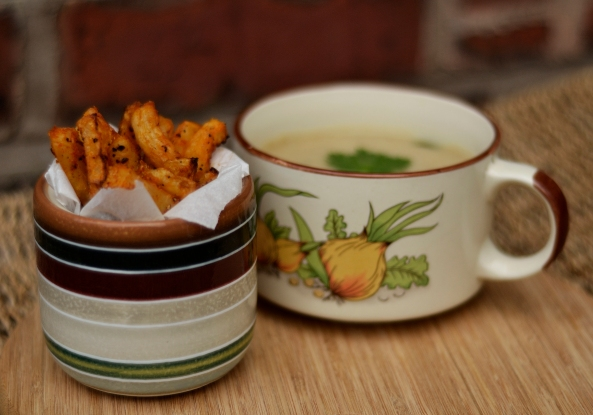 Curried cauliflower soup with spicy celeriac chips