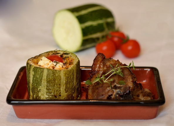 Stuffed baked marrow with thyme baked lamb